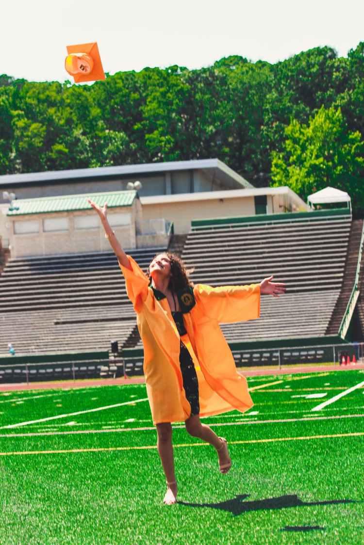 woman in orange academic dress